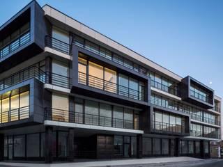 Edifício de habitação em V. N. de Tazém: Habitações  por Nuno Ladeiro, Arquitetura e Design