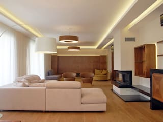 Modern living room by Tolga Archıtects Modern