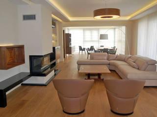 Salones de estilo moderno de Tolga Archıtects Moderno
