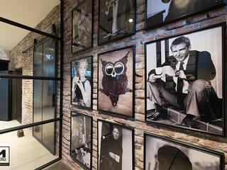Oficinas y bibliotecas de estilo industrial de Molitli Interieurmakers Industrial