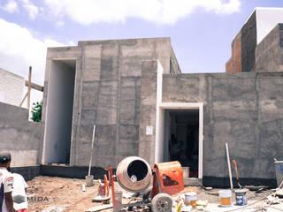 Casa Josefina: Casas de estilo  por MIDA