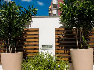 Paisagismo em condomínio:   por Grama Arquitetura