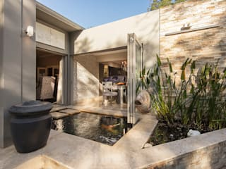 The Fish Pond:  Bungalows by Spegash Interiors