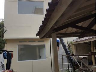 Renovasi di Jalan Teratai 16 - Bogor :modern  oleh CV.Emasna Propertindo Sentosa, Modern