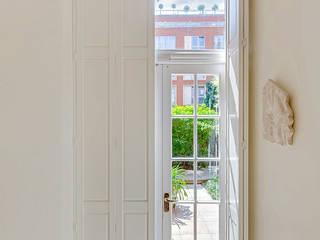 Solid Panel Shutters for Garden Doors:  Corridor & hallway by Plantation Shutters Ltd