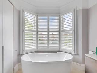 Bathroom Beauty Next to The Home of Fulham Football: modern Bathroom by Plantation Shutters Ltd