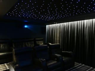 Dedicated Cinemascope 4K Cinema Room with Dolby Atmos sound system:  Media room by HiFi Cinema Ltd.