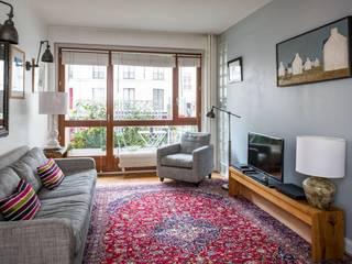 Rénovation complète d'un appartement à Paris:  de style  par Archionline