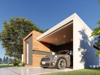 Até a garagem foi valorizada: Casas  por Vortice Arquitetura