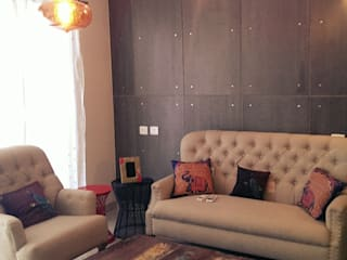 MODEL FLAT,PBEL CITY–HYDERABAD:  Living room by Crafted Spaces