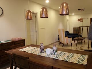 MODEL FLAT-PBEL CITY, CHENNAI:  Dining room by Crafted Spaces