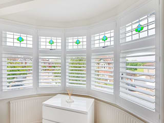 Full Height Shutters in the Master Bedroom: classic Bedroom by Plantation Shutters Ltd