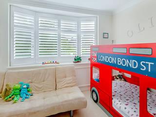 Full Height Shutters in a Kids Bedroom: classic Bedroom by Plantation Shutters Ltd