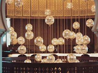 Restaurantes de estilo  por Ro Lighting Design