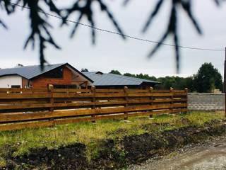 Vista Exterior Sur: Chalets de estilo  por Nomade Arquitectura y Construcción spa
