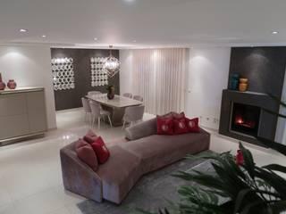 Perspectiva geral da sala de estar e jantar: Salas de estar modernas por Alma Braguesa Furniture