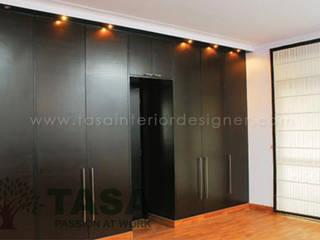 Wardrobe Designs:   by TASA interior designer