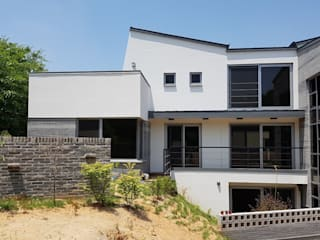 Casas de estilo rural de 건축사사무소 CSU Rural