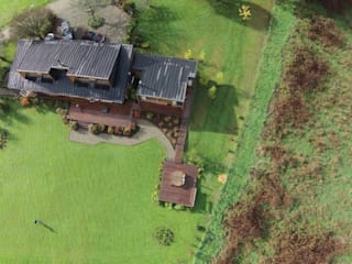 CASA LMA: Casas de estilo  por KOMMER ARQUITECTOS