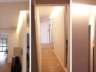 Remodelação total - Apartamento no Largo do Rato: Corredores e halls de entrada  por CVZ Construcoes