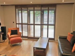 A Completely Transformed Living Room In Wandsworth Plantation Shutters Ltd Ruang Keluarga Modern Kayu Brown