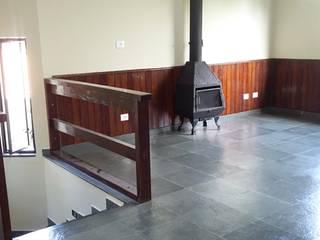 Construtora: Salas de estar  por AGM Construções e Reformas ,Rústico
