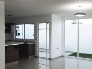 Interiores: Cocinas de estilo minimalista por INZAR