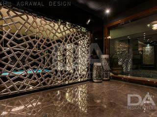 Hand Cut screen serving as an aesthetic partition Modern walls & floors by Design Atelier Modern
