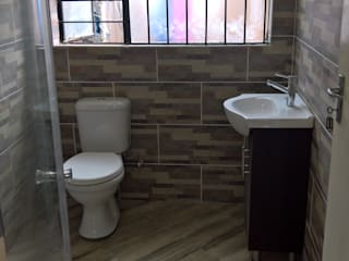 Bathroom by Kgodisho Solutions and Projects