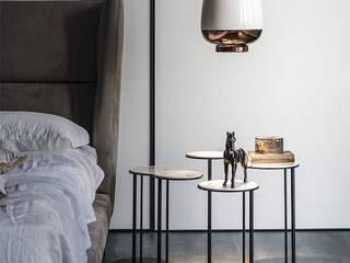 Industrial meets modern:  Bedroom by Adore Design,
