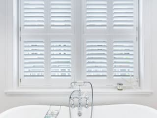 A Wonderfully Pristine Home in Battersea Plantation Shutters Ltd Modern style bathrooms Wood White