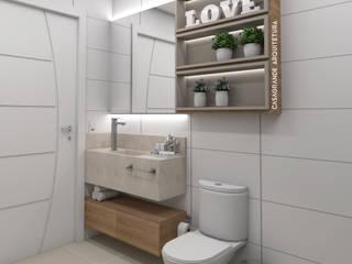 Banheiro Simples: Banheiros  por CASAGRANDE ARQUITETURA