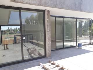 Cerramiento:  de estilo  por M.i. arquitectura & construcción