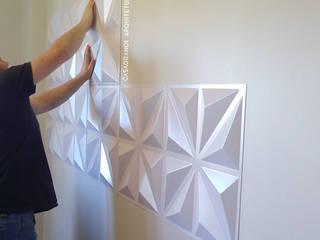 Instalação do revestimento 3D:   por CASAGRANDE ARQUITETURA