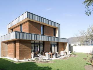 Maison D: Maison individuelle de style  par DESarchitecture