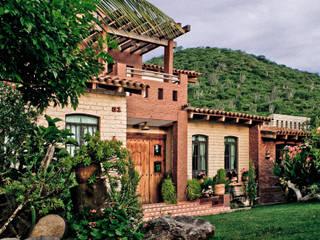 Exterior Casas rústicas de Orlando Quiñones Rústico Hierro/Acero