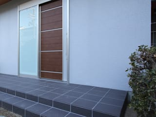 鉄筋コンクリート構造のキッチンを中心としたバリアフリー住宅 の 無二建築設計事務所 モダン