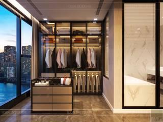 Thiết kế nội thất hiện đại tinh tế ở căn hộ Vinhomes Central Park Phòng thay đồ phong cách hiện đại bởi ICON INTERIOR Hiện đại