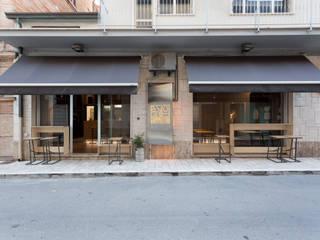 GRAMMI LITRO Bar & Club in stile industrial di Maranco Architetti Industrial