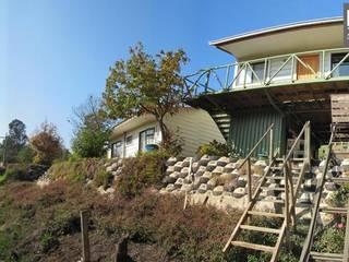 Casas de estilo rural de Lau Arquitectos Rural