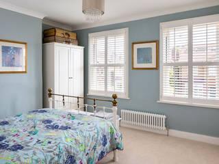 Full Height Shutters in the Bedroom Modern style bedroom by Plantation Shutters Ltd Modern Wood Wood effect