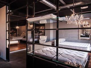 Showroom Materassi ANTUORI Negozi & Locali commerciali in stile industrial di Farre+Stevenson Architettura Industrial