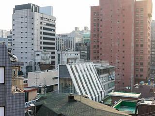 라파엘빌딩 | 근린생활시설: 보편적인 건축사사무소의  상업 공간