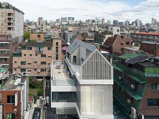 논현동 홀스(Holls)빌딩|근린생활시설: 보편적인 건축사사무소의  상업 공간