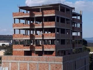 Edifício Residencial / Comercial por CBC Engenharia Moderno