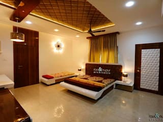 RAVI - NUPUR ARCHITECTS Modern style bedroom Beige