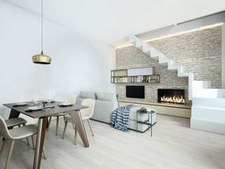 zona giorno con biokamino e scala a vista: Sala da pranzo in stile  di Silvana Barbato, StudioAtelier