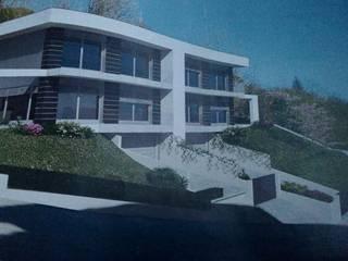 Facciata  con ampi terrazzi: Villa in stile  di Silvana Barbato, StudioAtelier