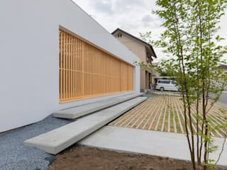 Single family home by インデコード design office,