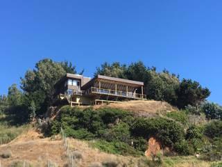 Vista : Casas unifamiliares de estilo  por LEON CAMPINO ARQUITECTURA SPA